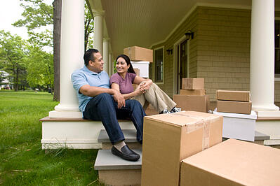 couple_with_boxes_important_moving_tips_Cook_Portable_Warehouses