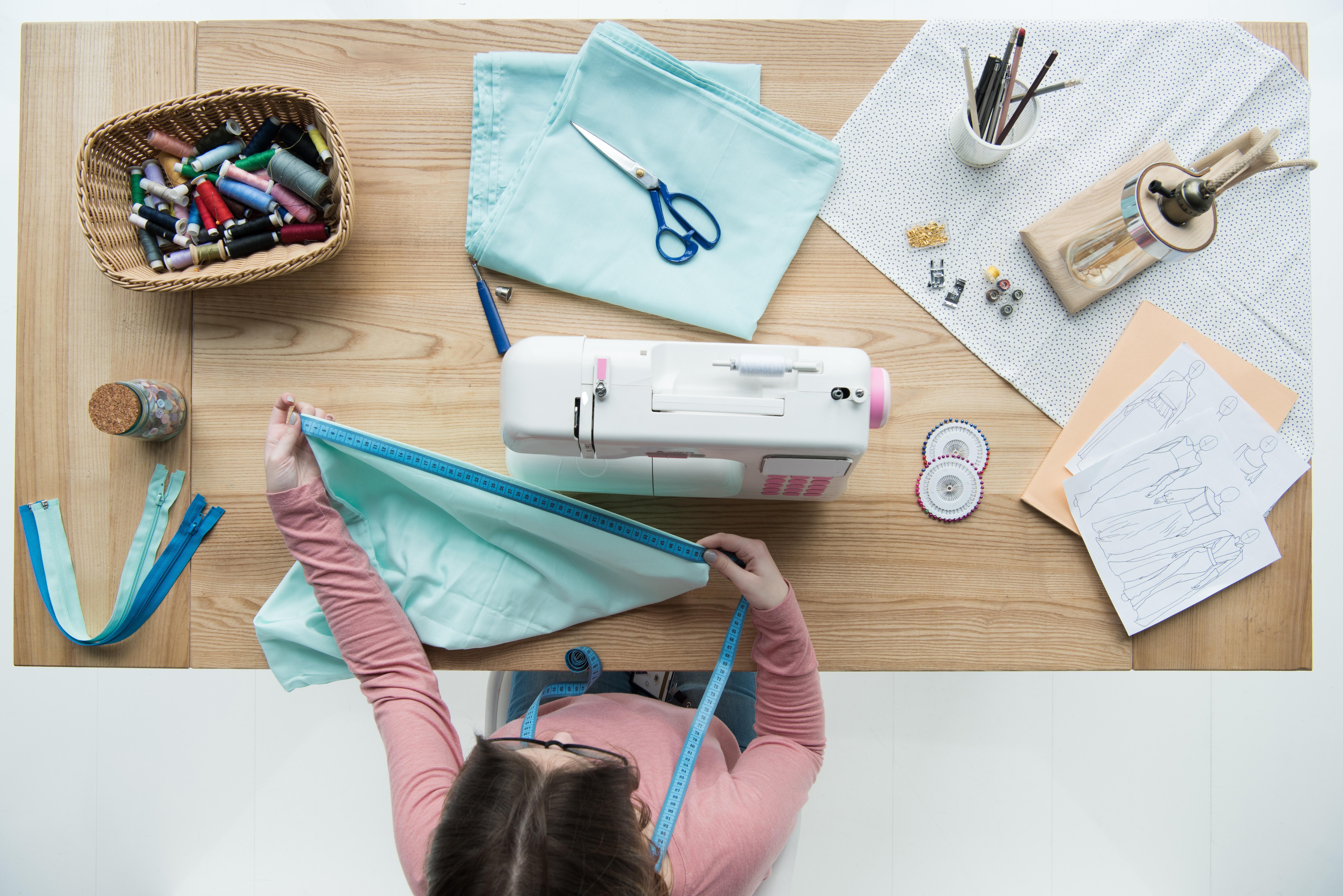 Girl sitting at sewing machine