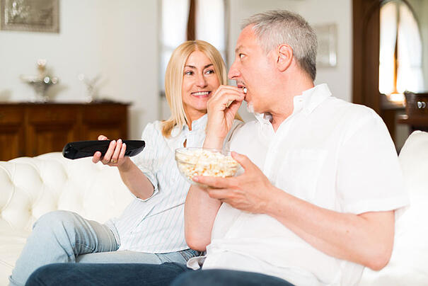 Couple watching TV and talking