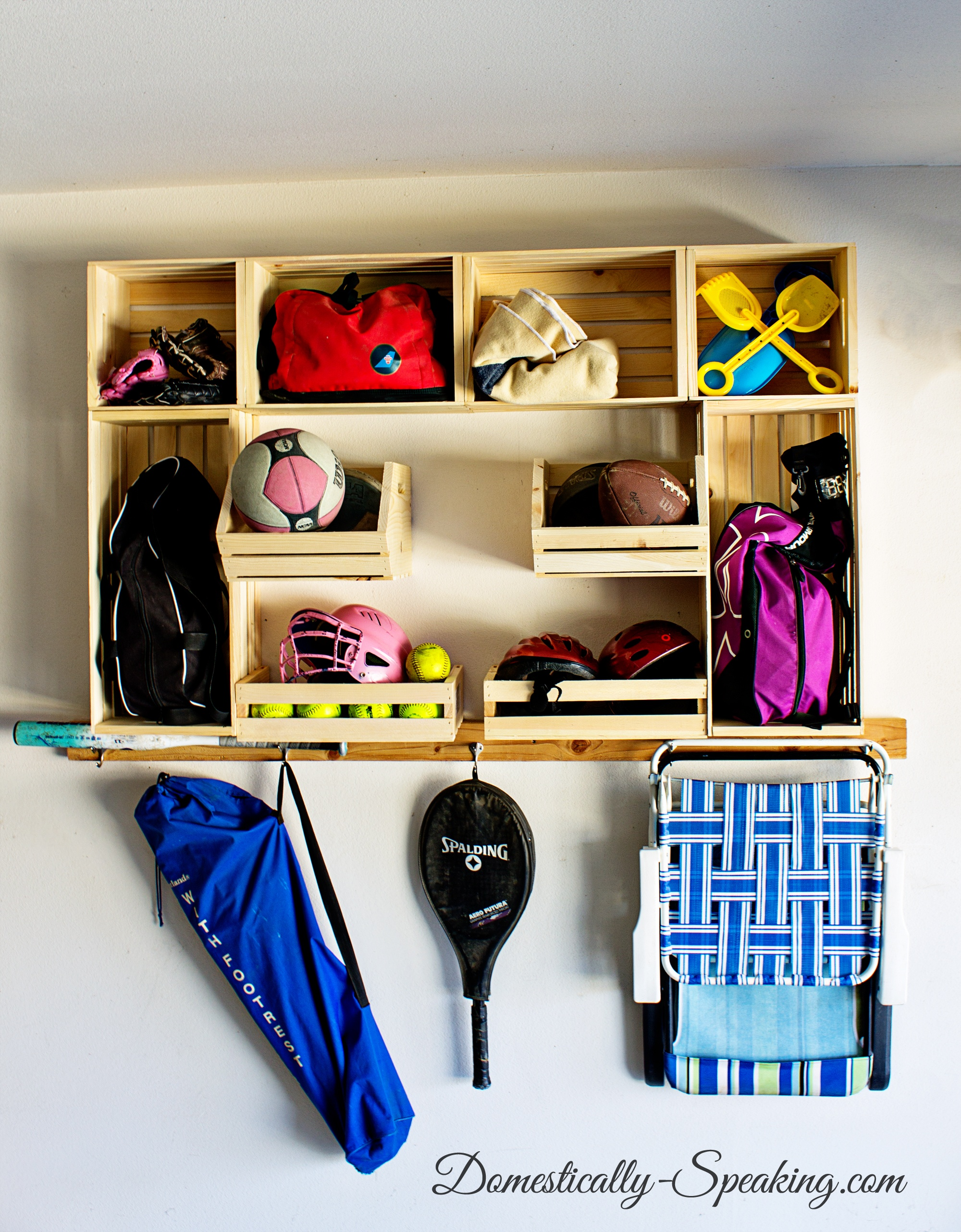 Garage-Sports-Organization-with-Crates from domestically speaking