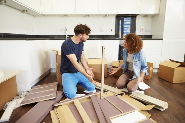 Couple building something in floor