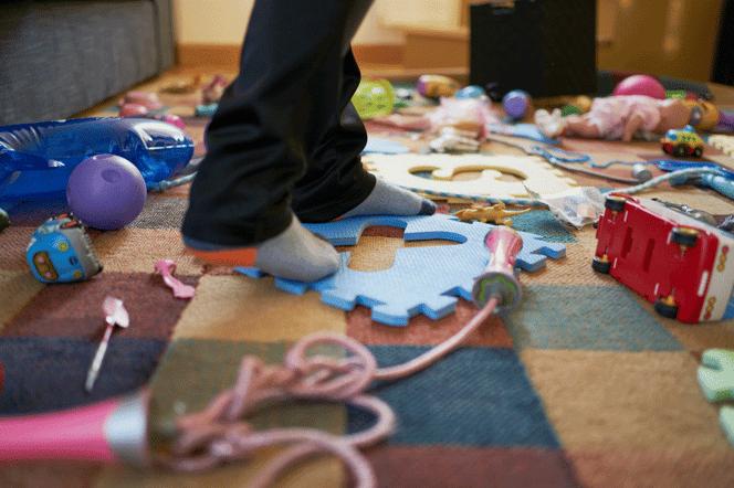 walking-on-kids-mess-AdobeStock_354360430